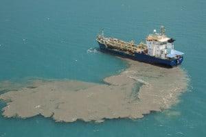 The dredge ship 'Brisbane' dumps maintenance dredge spoil in the World Heritage area. Photo (c) Xanthe Rivett / CAFNEC / WWF