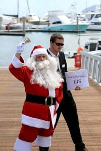 CAFNEC Marine Response Team volunteers act as Santa and the Government respectively to draw attention to the potential hiding of the Cairns dredging EIS behind Christmas.
